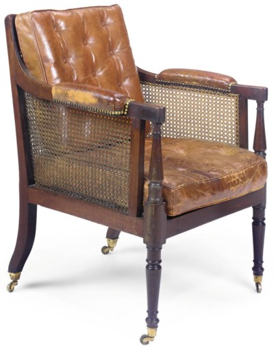 A MAHOGANY AND TAN LEATHER UPH