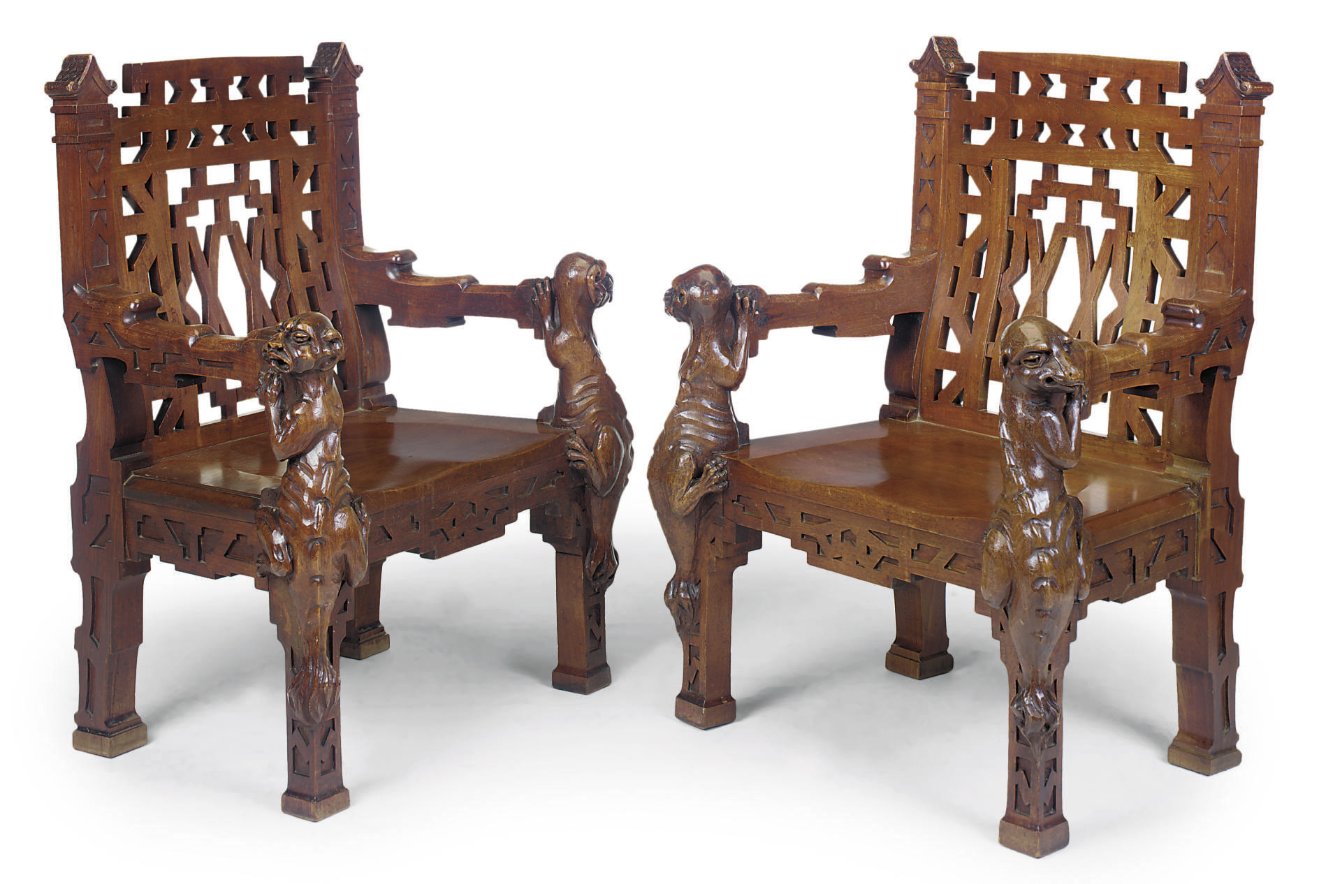 A PAIR OF COLONIAL TEAK ARMCHA