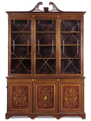 AN EDWARDIAN MAHOGANY CROSSBAN