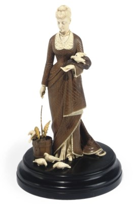 A FRENCH CARVED IVORY AND WOOD