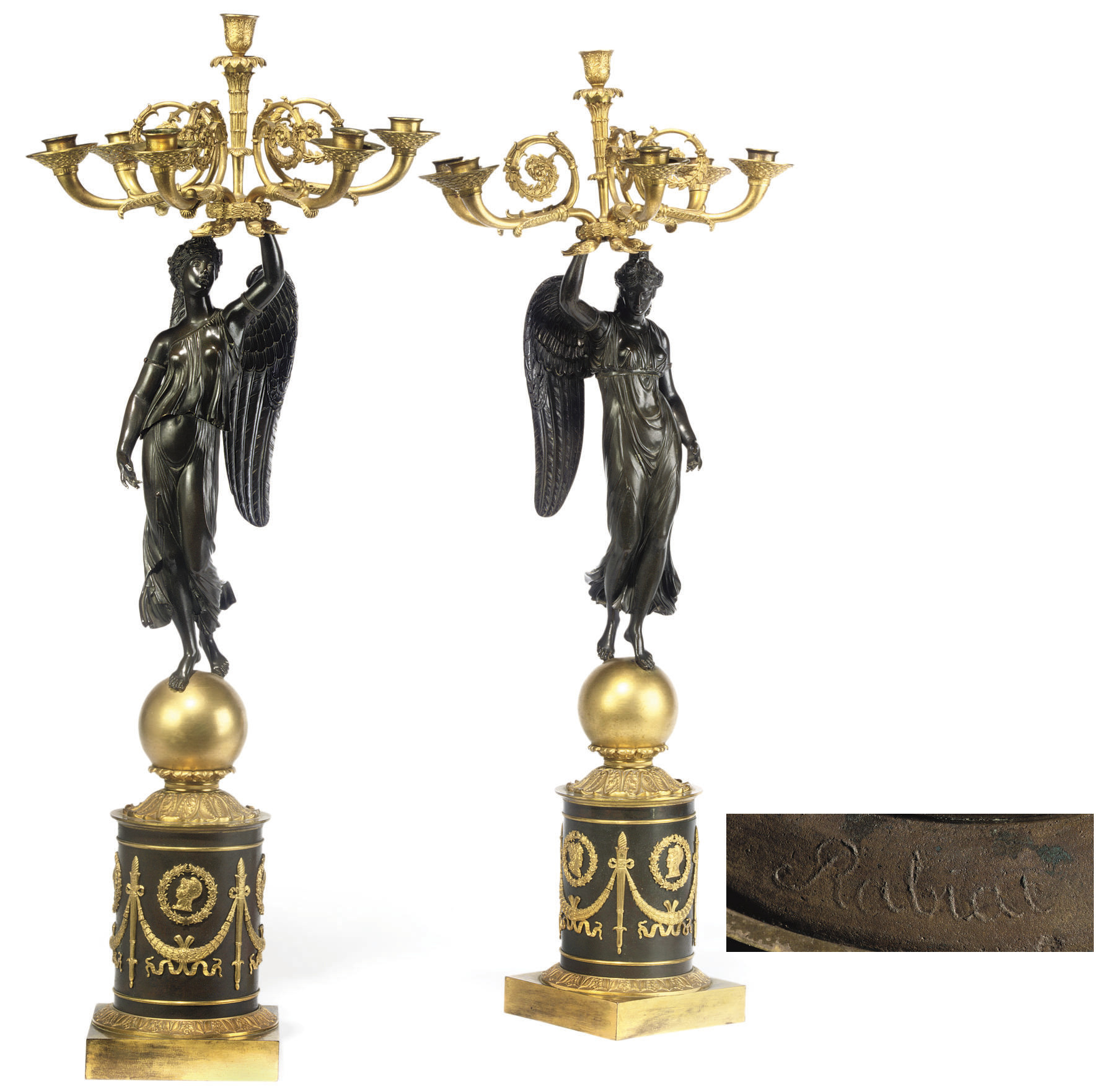 A PAIR OF EMPIRE ORMOLU AND PATINATED BRONZE SIX-LIGHT CANDELABRA
