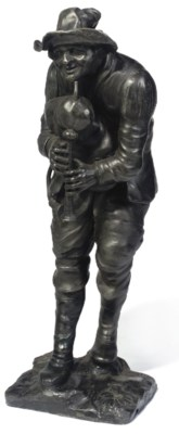 A LEAD FIGURE OF A PIPER