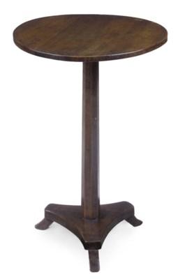 A FRENCH WALNUT CIRCULAR TABLE