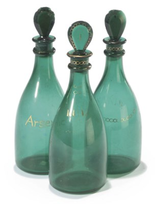 A SET OF THREE GREEN GLASS MAL