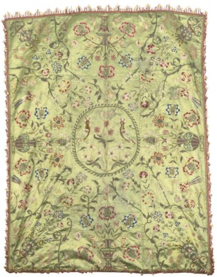 AN EMBROIDERED SILK COVERLET