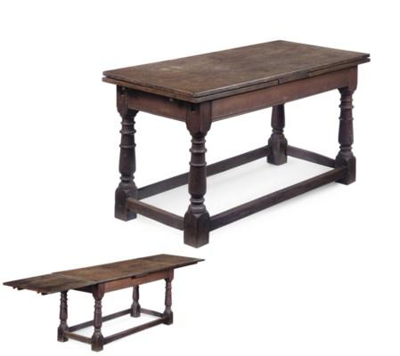 A DEVON OAK DRAW-LEAF TABLE