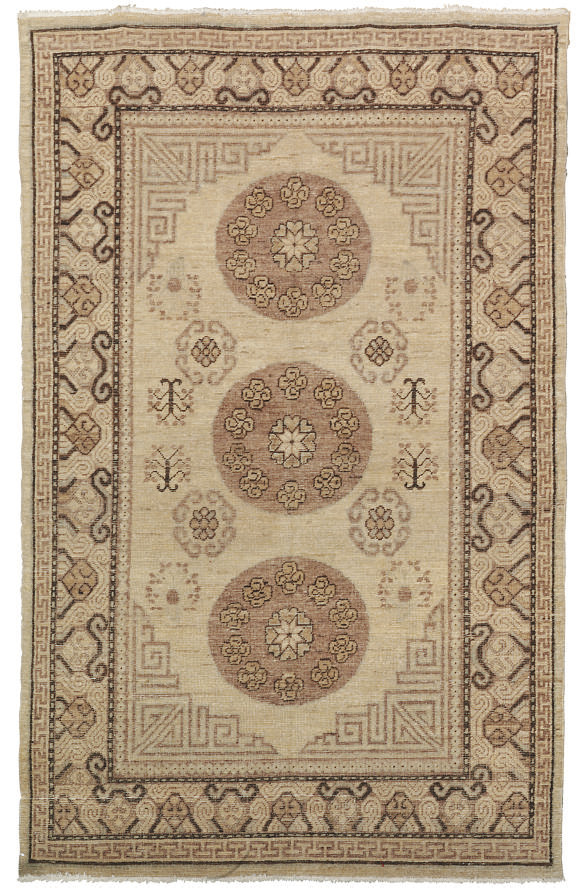 An antique Khotan large rug