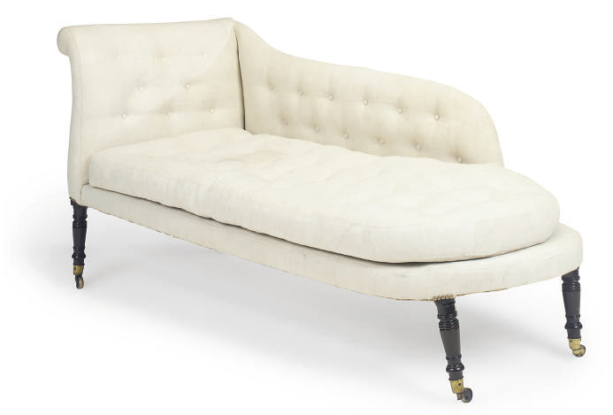 A REGENCY EBONISED CHAISE LONG