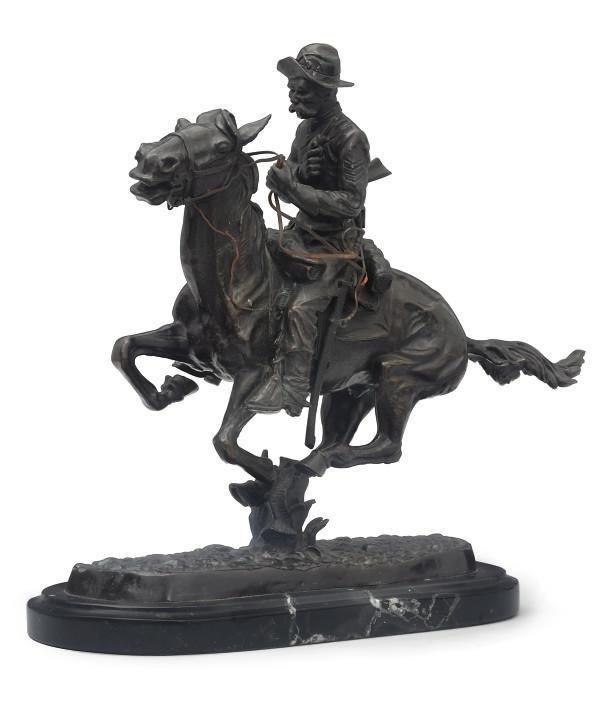 A BRONZE OF A COWBOY ON HORSEB