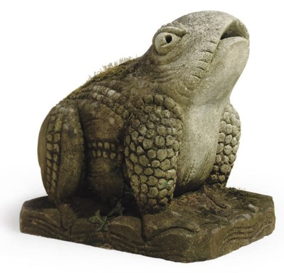 A CARVED STONE MODEL OF A FROG