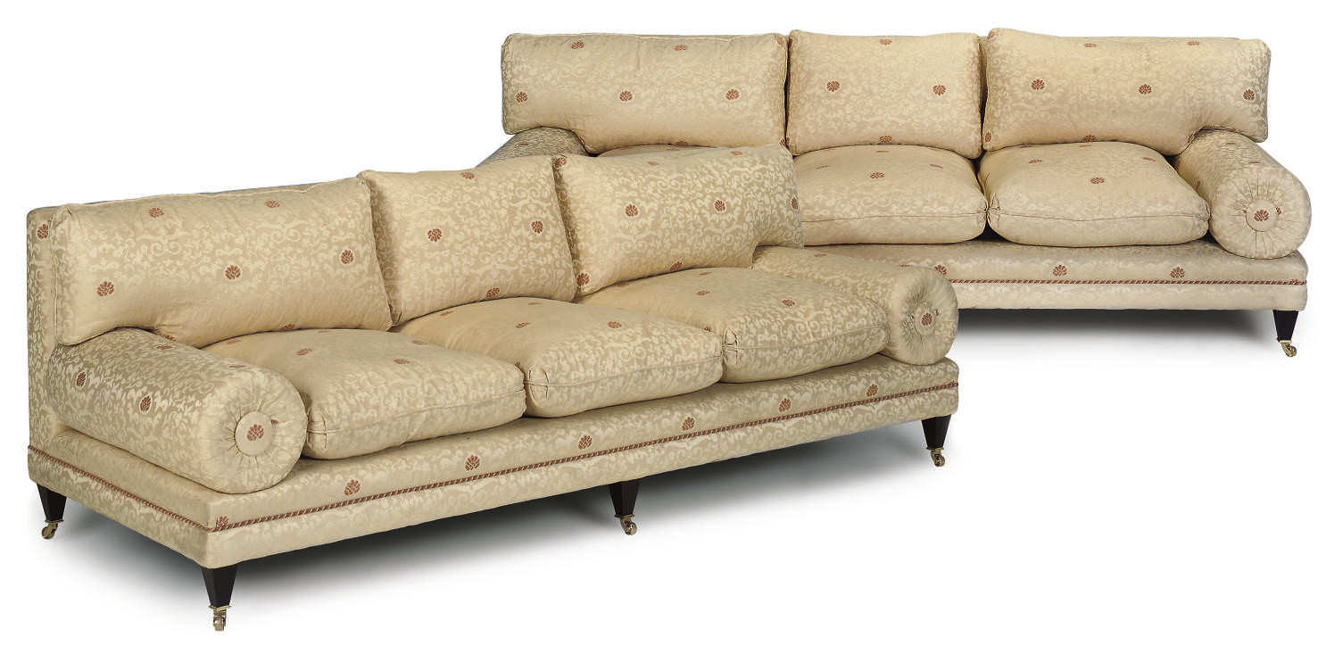 A PAIR OF UPHOLSTERED SOFAS