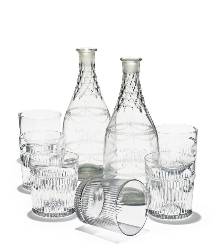 A PAIR OF GLASS DECANTERS AND