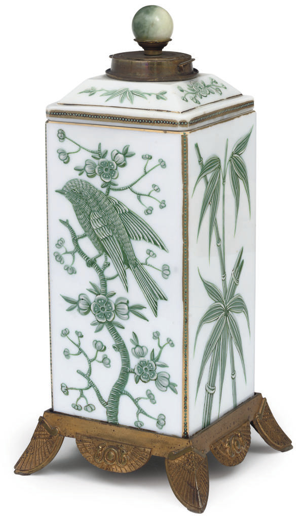 A WHITE OPALINE GLASS VASE AND