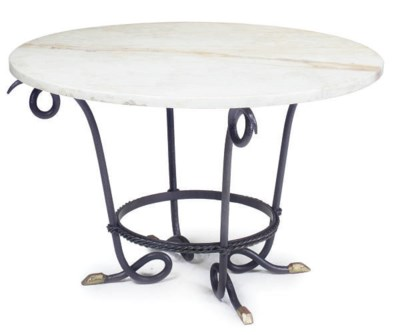 A WROUGHT IRON CENTRE TABLE