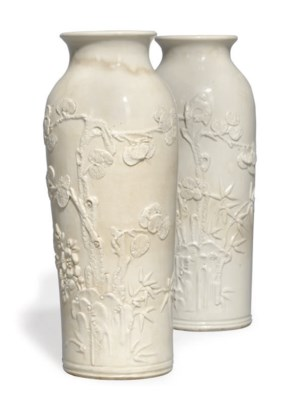 A PAIR OF CHINESE CREAM GLAZED