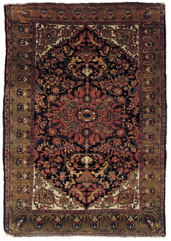 An antique Feraghan rug
