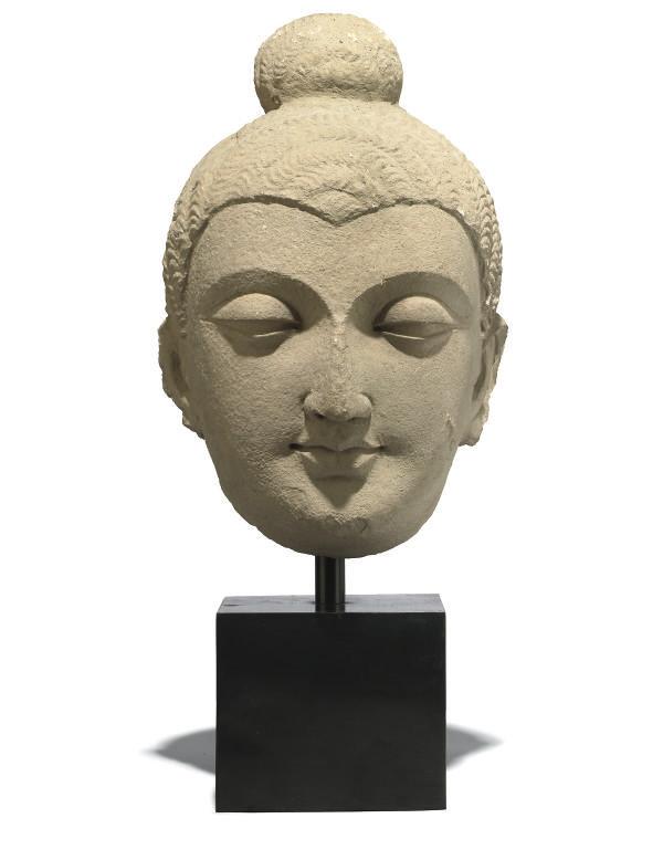 A GANDARAN STYLE STUCCO BUDDHA