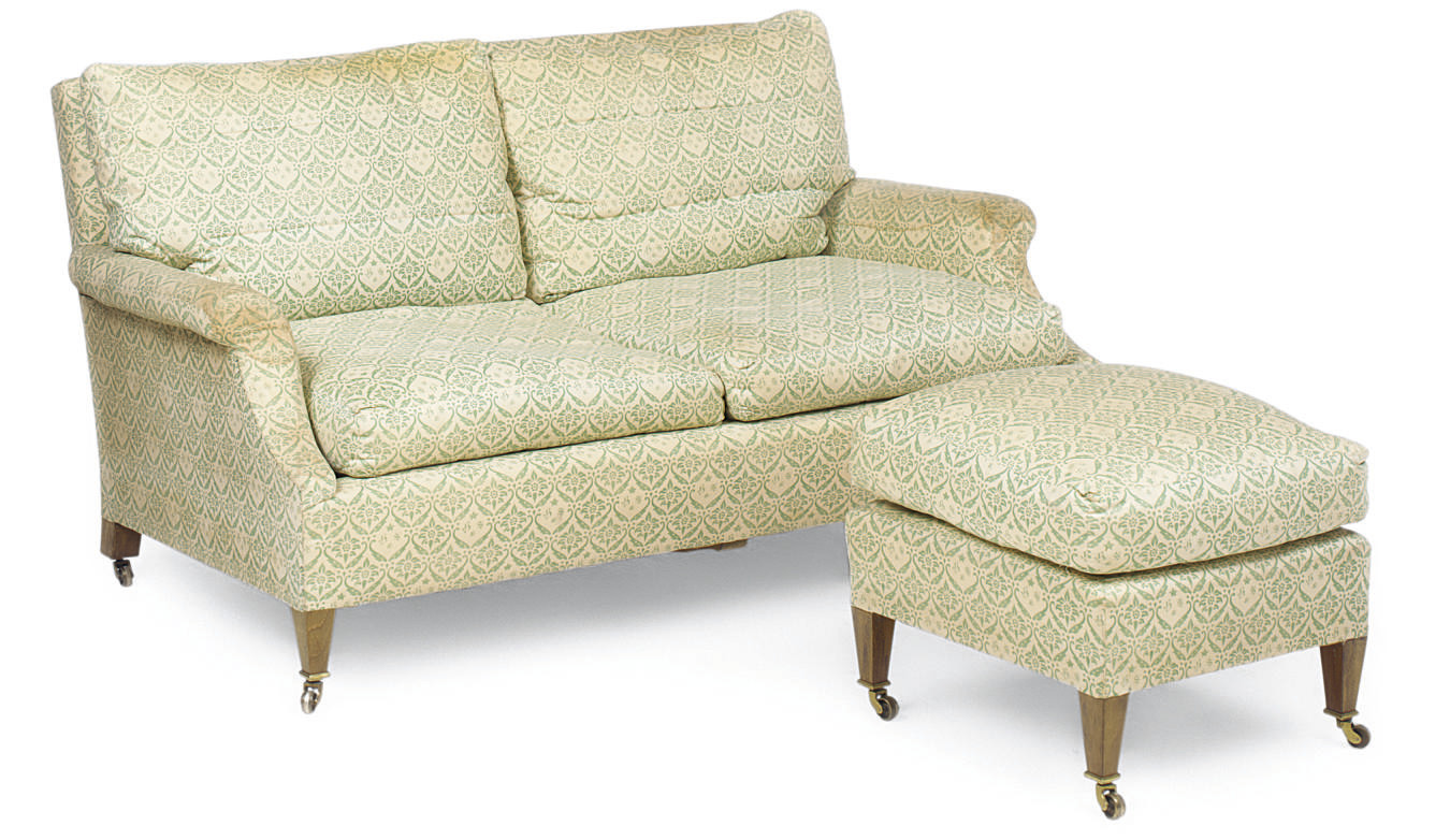A HOWARD SOFA AND STOOL