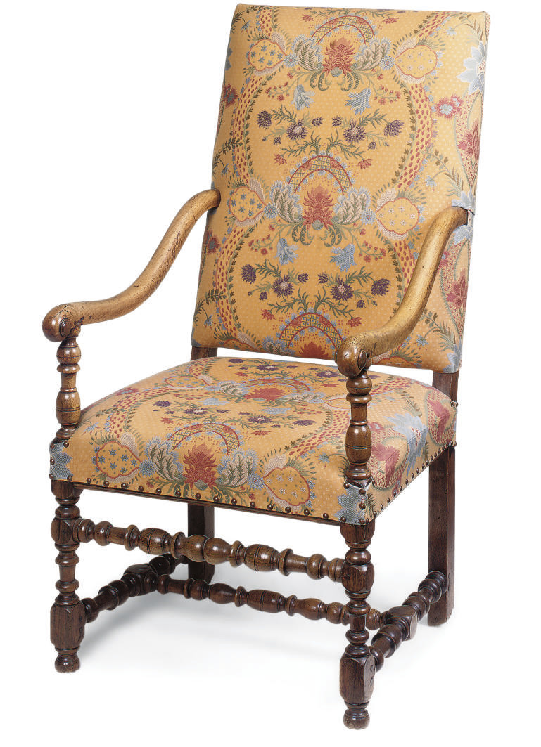 A FRENCH WALNUT ARMCHAIR