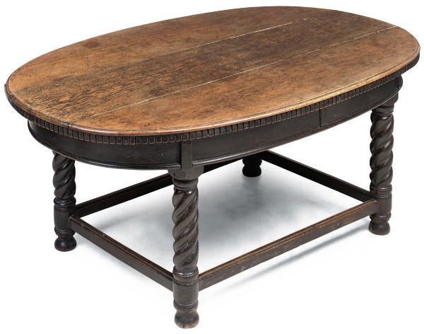 AN OVAL OAK CENTRE TABLE