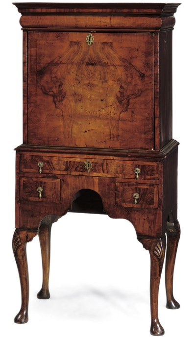 A WALNUT SECTAIRE ON STAND