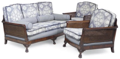 A WALNUT AND CANED BERGERE SUI
