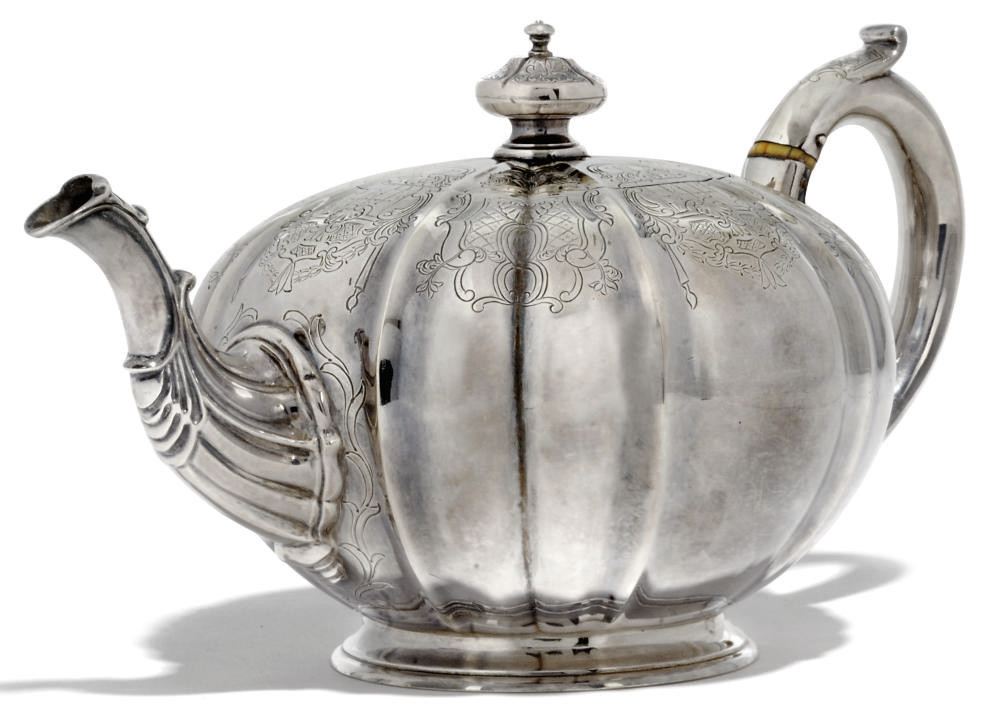 A VICTORIAN SILVER MELON-FLUTED TEAPOT