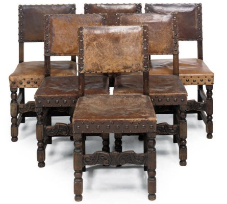 A SET OF SIX OAK CHAIRS