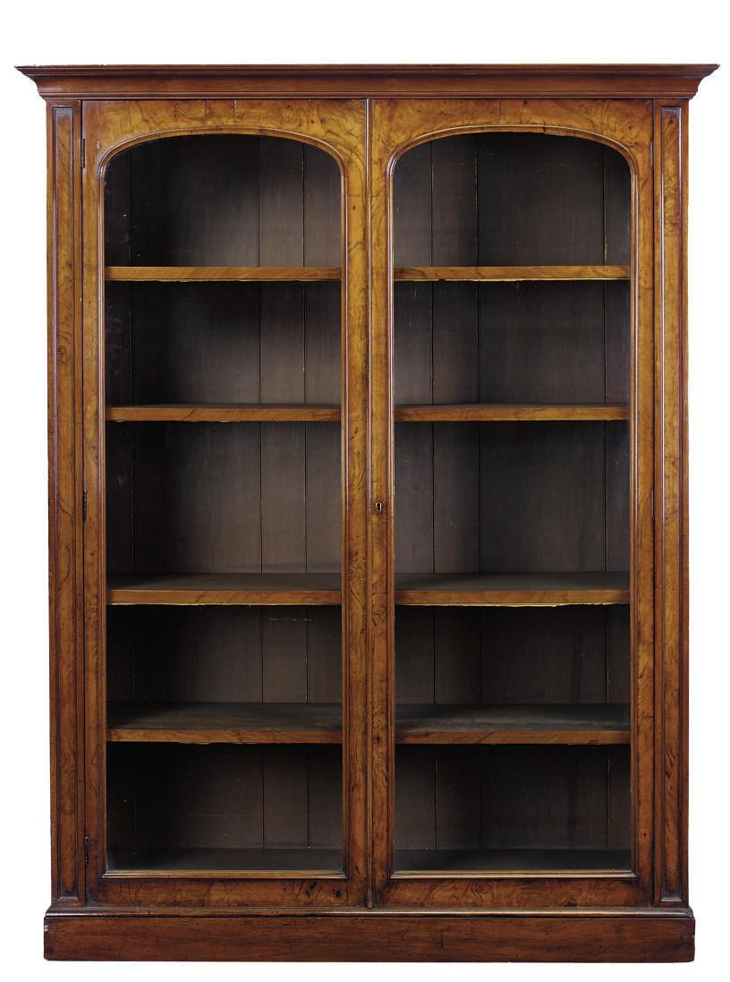 A VICTORIAN WALNUT BOOKCASE