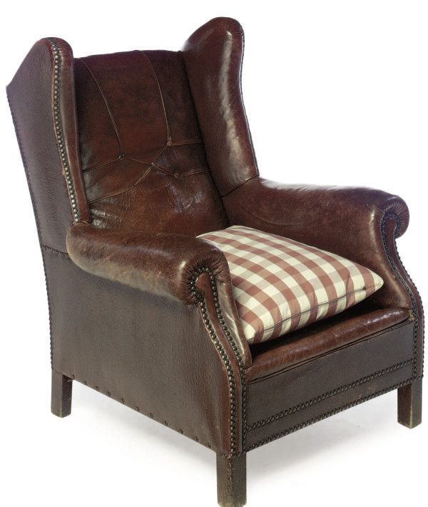 A LEATHER UPHOLSTERED WING ARM