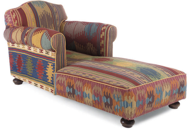 A KILIM UPHOLSTERED DAYBED