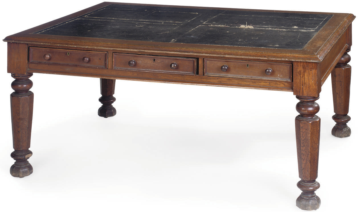 A VICTORIAN OAK LIBRARY TABLE