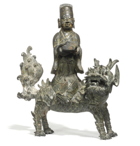 A CHINESE BRONZE GROUP OF A SC