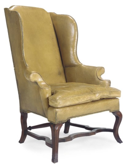 A LEATHER UPHOLSTERED WINGBACK