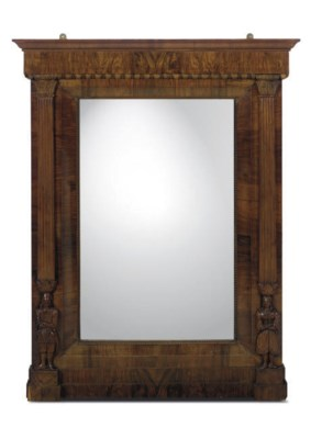 A MAHOGANY-FRAMED MIRROR