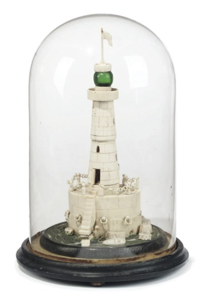AN IVORY MODEL OF A LIGHTHOUSE