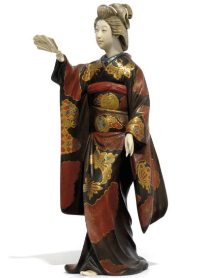 A Japanese lacquer and ivory o