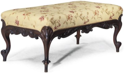 A VICTORIAN UPHOLSTERED WALNUT