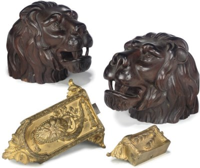 A PAIR OF CARVED MAHOGANY LION