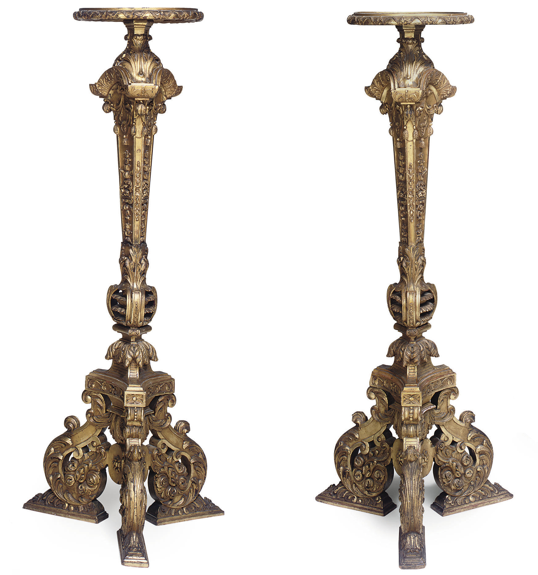 A PAIR OF CARVED GILTWOOD TORCHERES