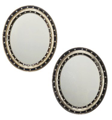 A PAIR OF OVAL GILT AND EBONIS