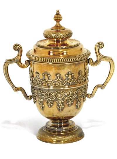AN EDWARDIAN SILVER-GILT CUP A