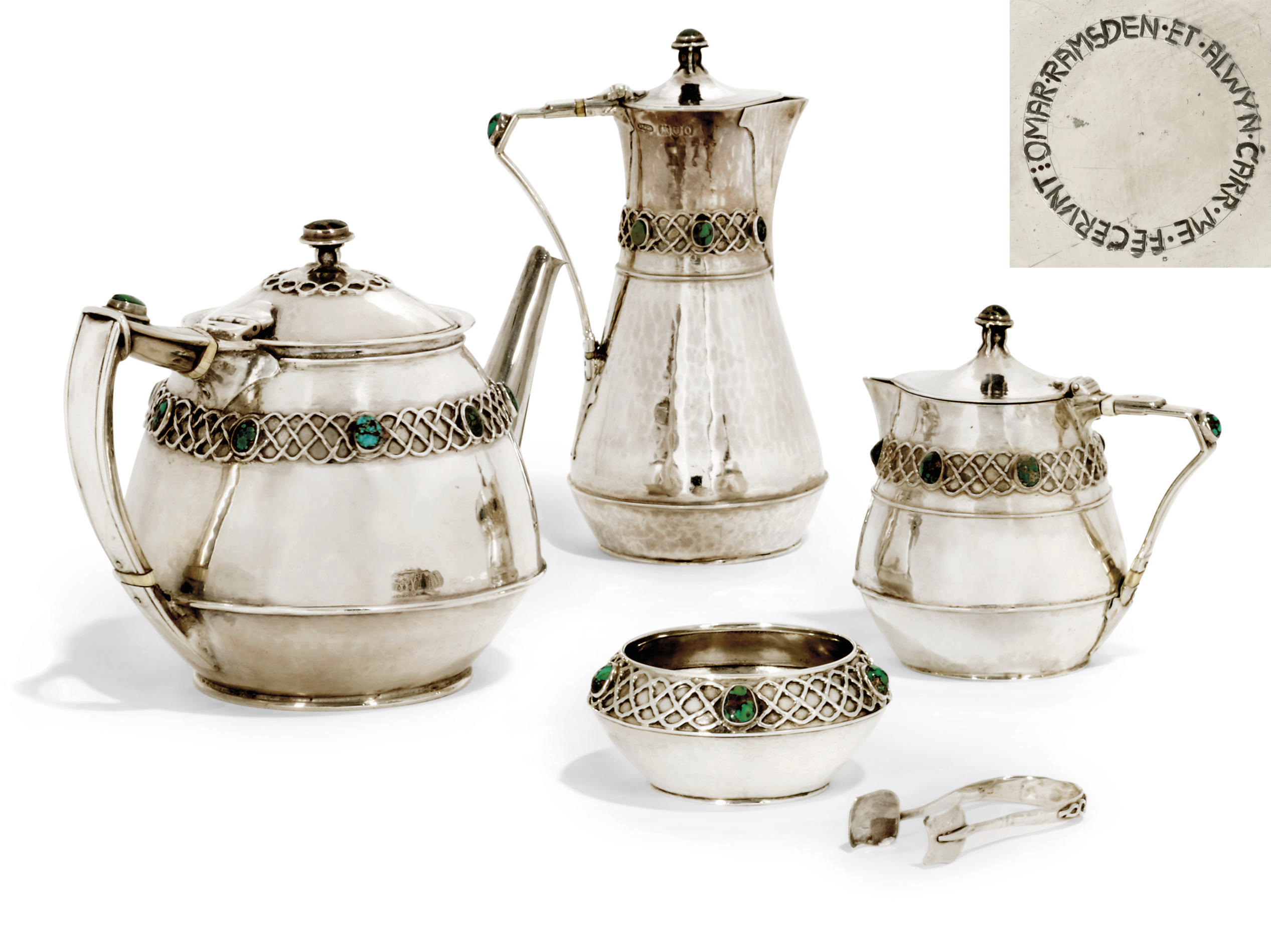 AN EDWARDIAN ARTS & CRAFTS FOUR-PIECE SILVER TEA SET