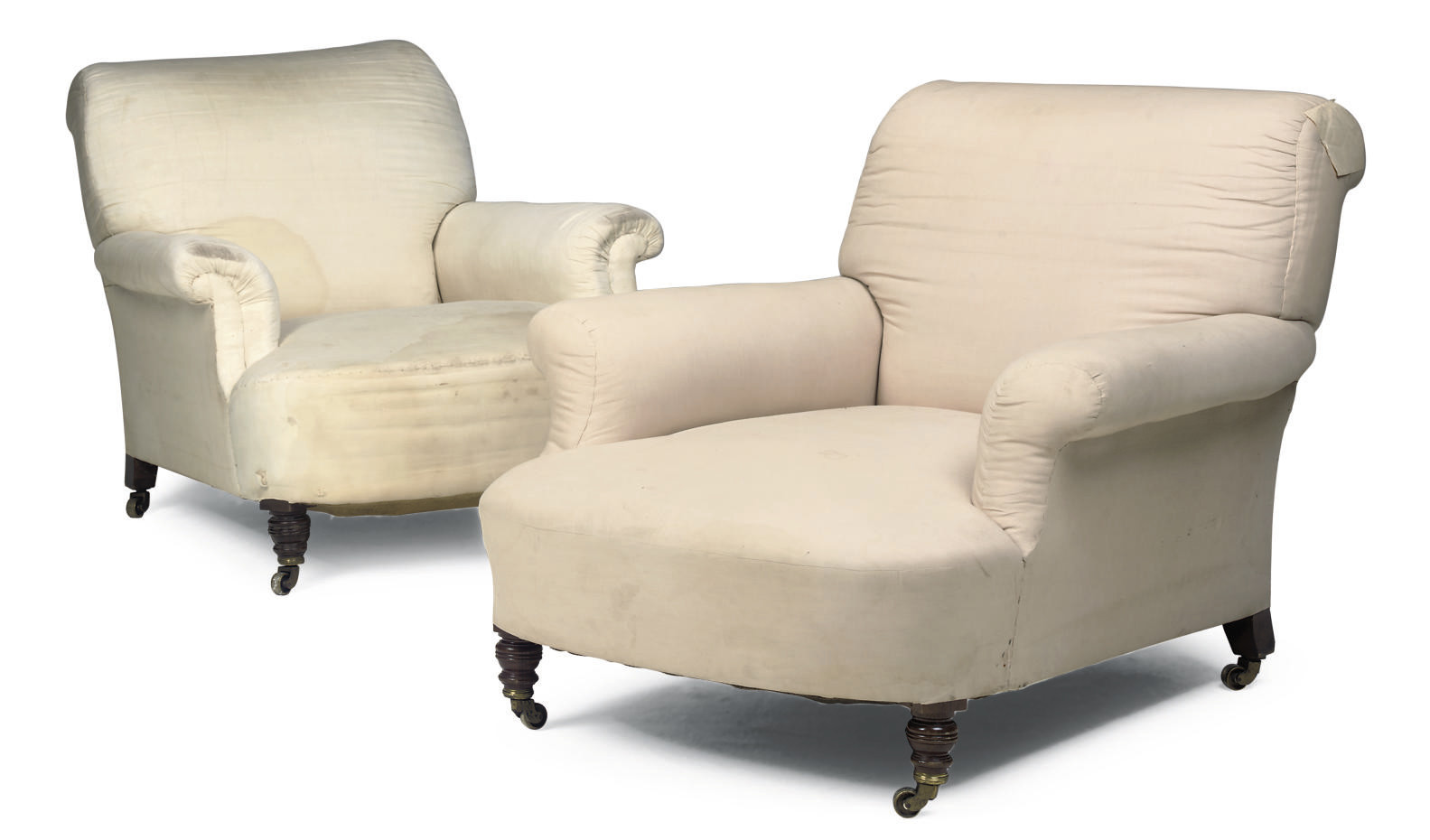 A MATCHED PAIR OF HOWARD ARMCHAIRS