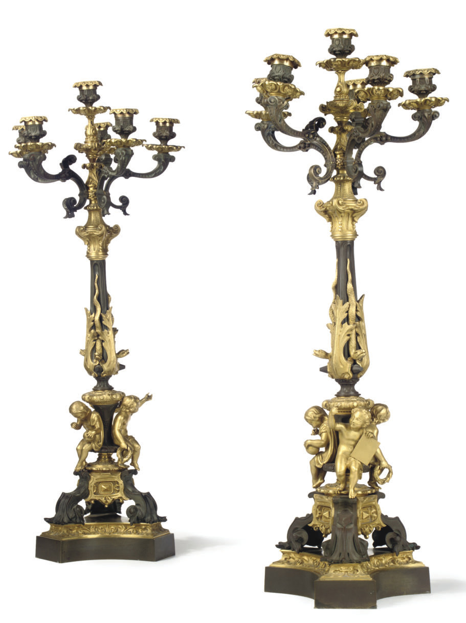 A PAIR OF FRENCH GILT AND PATINATED BRONZE SIX-LIGHT CANDELABRA