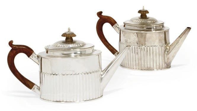 A PAIR OF GEORGE III SILVER TE