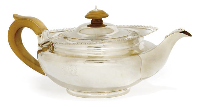 A GEORGE III SILVER TEPOT
