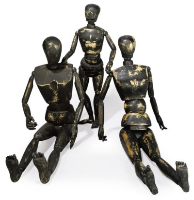 A SET OF THREE CARVED AND STAI