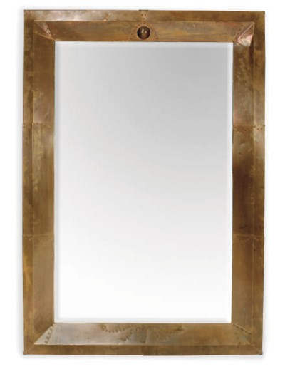 A LARGE ENGLISH COPPER MIRROR