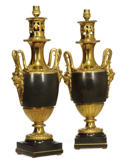 A PAIR OF BRONZE AND PARCEL GI